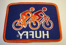 Vintage Huffy With Bike Riders Fabric Patch In Blue And Oran